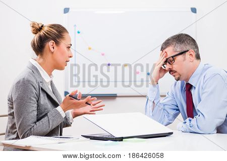 Businessman is getting fired by his boss.