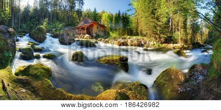 Austria panorama landscape with waterfall and watermill near Salzburg Golling Alps