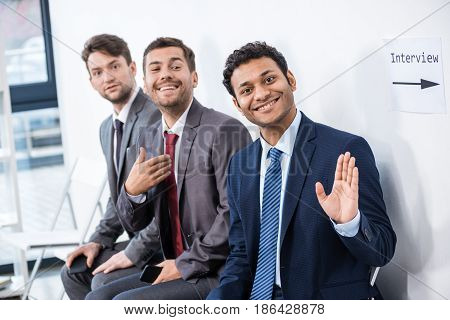 Businessmen Sitting In Queue And Waiting For Interview In Office, Business Concept