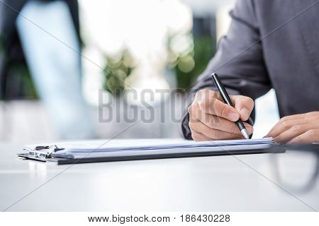Cropped Shot Of Businessman In Formal Wear Signing Contract At Workplace, Business Concept