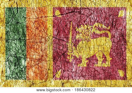 Grudge stone painted Sri Lanka flag close up