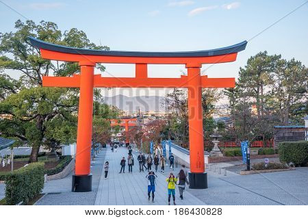 Kyoto Japan- November 282015 : Unidentified tourists visit Fushimi Inari Shrine the head shrine of Inari including trails up the mountain in Kyoto Japan.