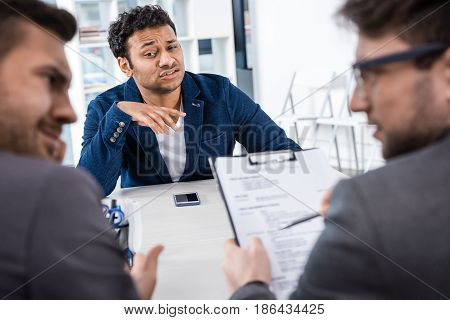 Grimace Businessman Sitting At Table During Job Interview, Business Concept