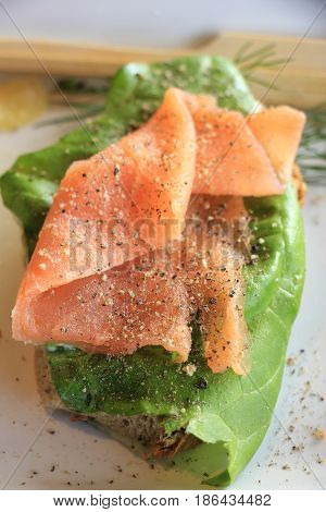 A fresh salmon sandwich: smoked salmon lettuce fresh dill and egg
