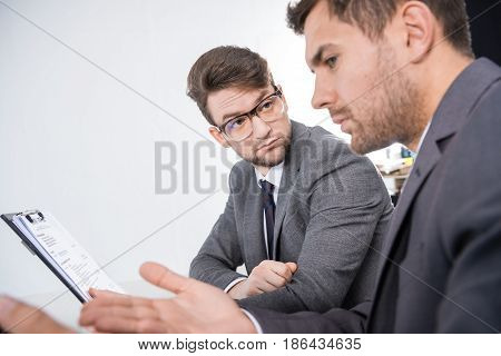 Side View Of Successful Businessmen Discussing Job Interview Contender