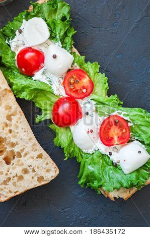 Freshly Baked Ciabatta Bread With Cherry Tomatoes Mozzarella Lettuce Salad Leaf Sour Cream Sauce San