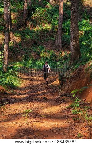 Tourist walk on the wild jungle. The concept of a healthy lifestyle.