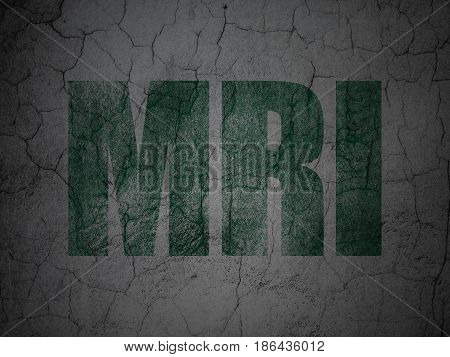 Health concept: Green MRI on grunge textured concrete wall background
