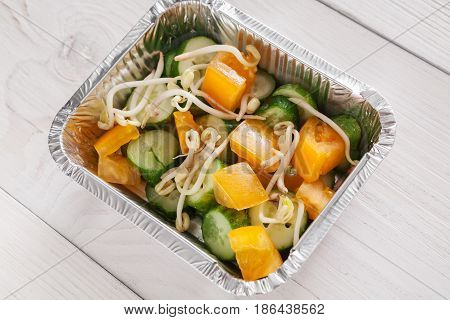 Healthy food, diet concept. Lunch box with Weight loss nutrition closeup. Soy sprouts salad