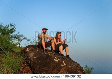 Tourists Watching The Sunset On Top Of The Mountain.