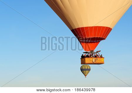 Basket With Tourists Of Hot Air Balloons Flying Over Valley In The Morning. Cappadocia. Turkey