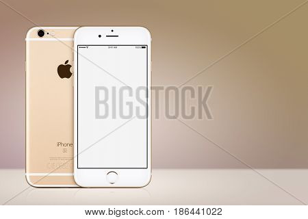 Varna, Bulgaria - March 10, 2016: Gold Apple iPhone 7 with white blank screen mockup front view and back side on gold gradient background with copy space. Quick mockup for your design.