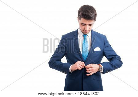 Man In Stylish Suit Is Buttoning His Jacket