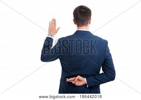 Salesman Promising An Oath With Crossed Fingers