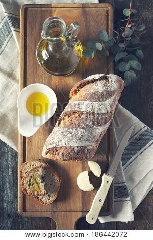 Appetizer: French country bread round cheese and olive oil. Toned image rustic style top view