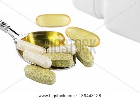 Vitamin complex omega 3 glucosamine capsules multivitamin supplements in the spoon and white container isolated on white background.