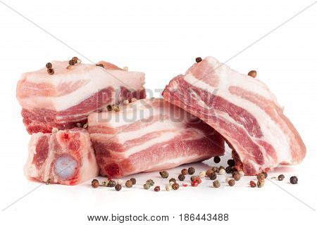 pieces of pork with peppercorn isolated on white background.