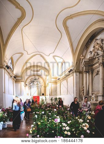 Este Italy 22 Apr 2017 - customers in a florist shop set up inside a deconsecrated church