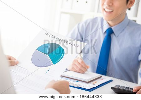 Businessman consulting with financial adviser about investment plan
