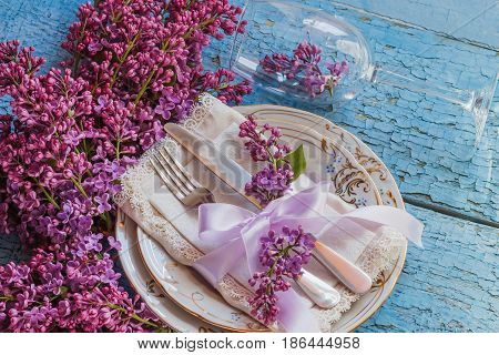 Tableware And Silverware With Violet Lilac On The Wooden Background