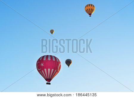 Hot Air Balloons Flying Over Valley. Cappadocia. Turkey