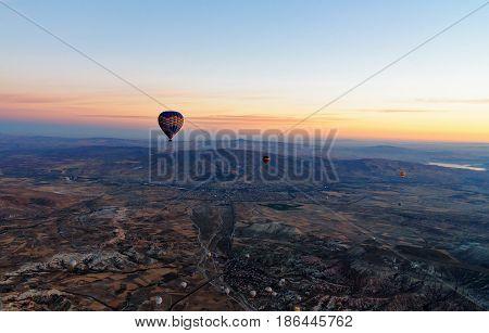 Hot Air Balloons Flying Over Valley At Sunrise. Cappadocia. Turkey