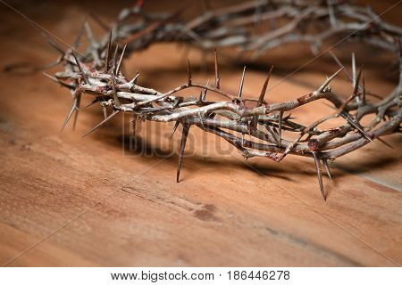Crown of thorns on wooden surface with copy space