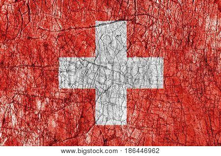 Grudge stone painted Switzerland flag close up