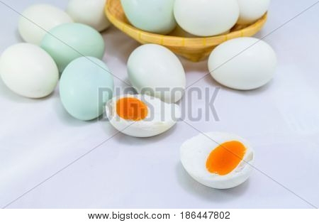 Salted duck egg in basket isolated on white background.