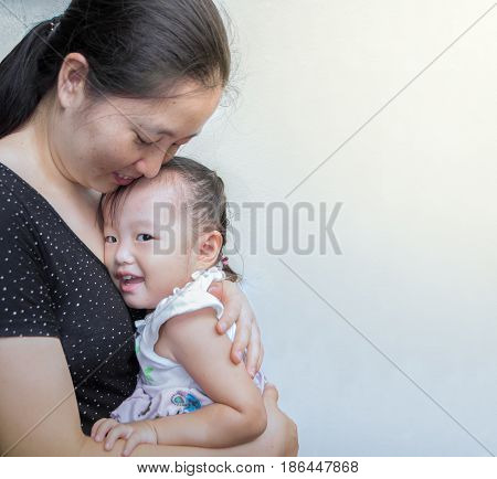 mother and child hugging and smile at home