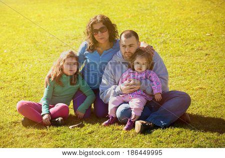 latin family in summer park