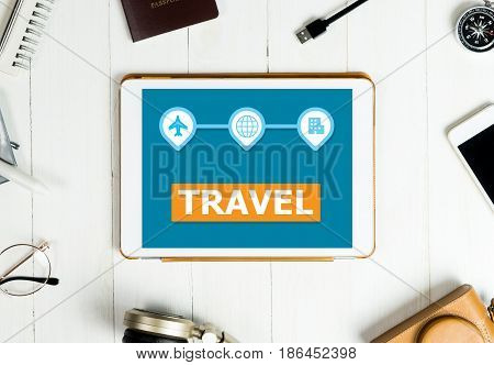 Travel Application screen on white tablet with travel accessories