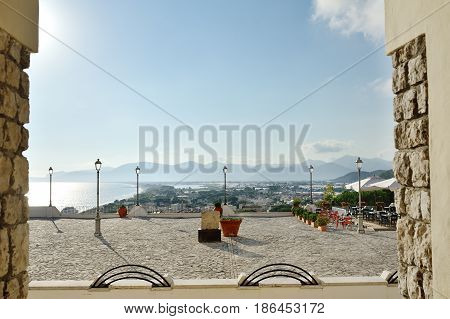 View of a square with lampposts and terrace overlooking the sea in Sperlonga Lazio Italy