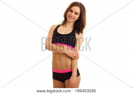 cutie young sports girl posing and smiling on camera isolated on white background