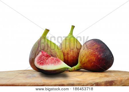 Close-up image of figs on cutting board with white background