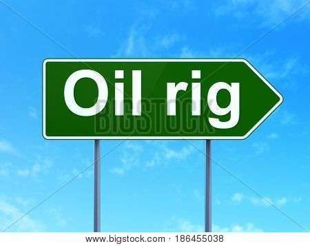 Manufacuring concept: Oil Rig on green road highway sign, clear blue sky background, 3D rendering