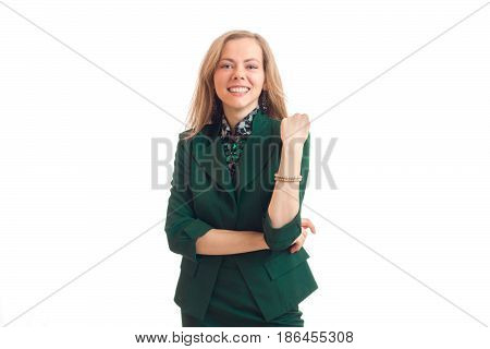 Cheerful young business girl in green unifrom smiling isolated on white background