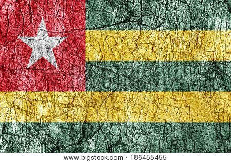 Grudge stone painted Togo flag close up