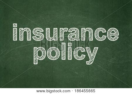 Insurance concept: text Insurance Policy on Green chalkboard background