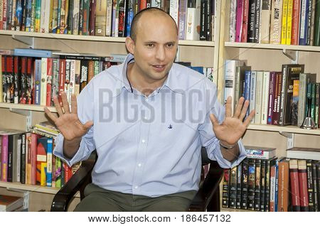 Naftali Bennett, Israeli politician, currently Education Minister, speaking before the Russian-speaking students inside the Fishka club. Tel Aviv, Israel, January 2013.