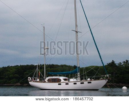 Sailboat anchored off the coast of Maine in Casco Bay.