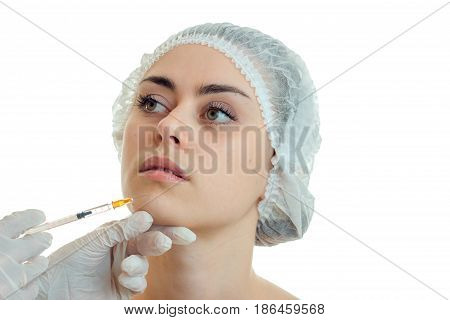 Cutie young girl with make up at plastic surgeon isolated on wite background