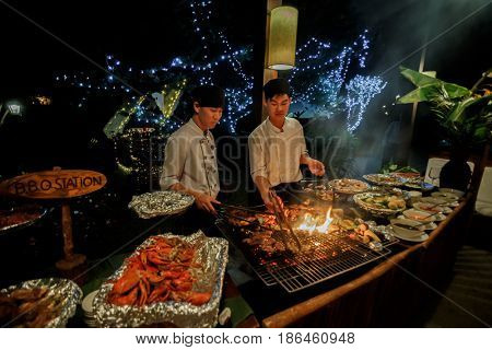 8 january 2017 Wedding party. Dalat, Vietnam. Seefood bbq outdoors at picnic, party, roasted meat and seafood grill at grate.