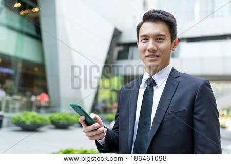 Businessman hold with mobile phone