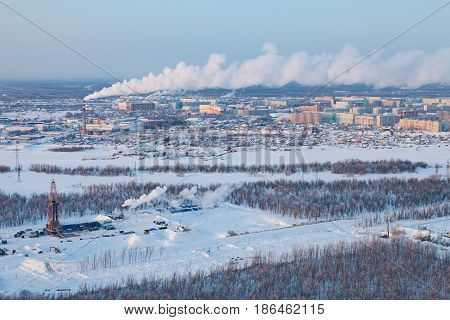 Aerial view of oil rig at an oil field on Megion town background in Western Siberia in the winter