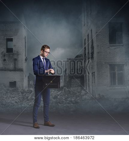 Businessman standing on apocalyptic background. Crisis, default, setback concept.