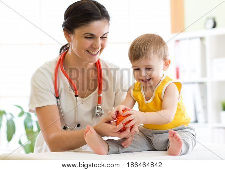 Doctor doing massage to little child patient using a ball