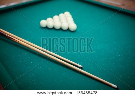 Billiard Balls And Two Cues In The Form Of A Triangle On The Billiard Table Are Ready For The Game.