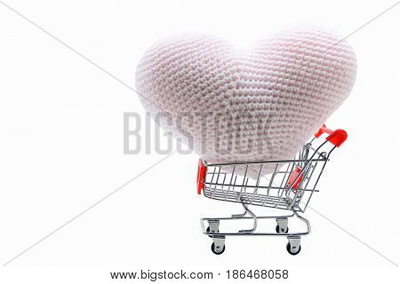 heart delivery in Shopping cart isolated on white