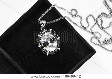 Large crystal medallion on silver chain in black jewel box